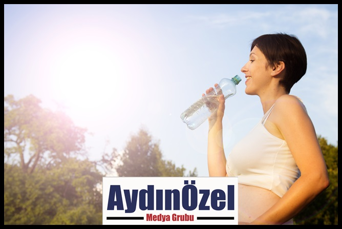 1543868974_graphicstock_portrait_of_young_pregnant_woman_drinking_water_rawtbri__-(1).jpg